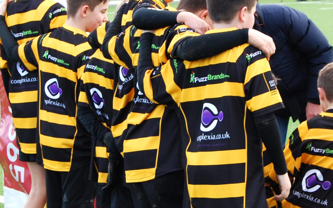 Group of Under 12s Rugby Players in new kit from their sponsors