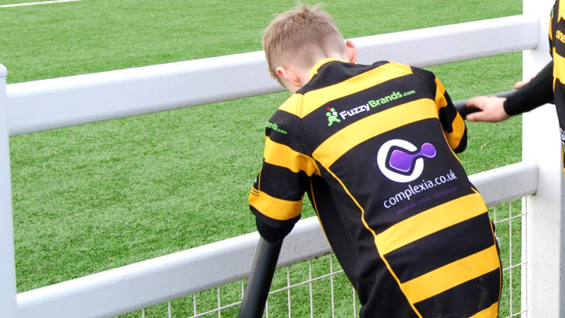 Boy stretching in new rugby kit, provided by the joint efforts of Complexia Ltd, Fuzzy Brands and Guy Taylor Associates.