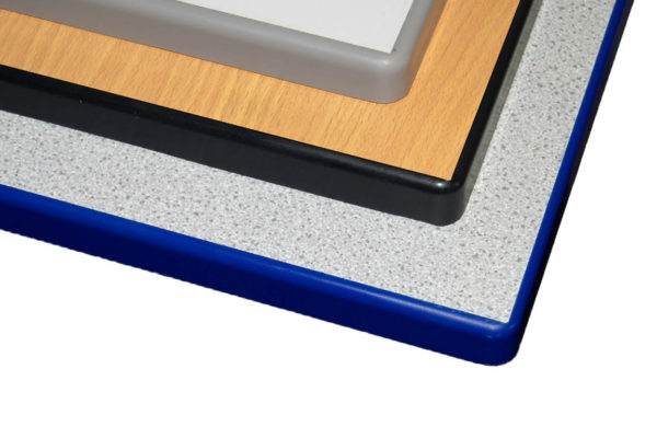 A layout of 3 school table top variants with polyurethane edging, in descending order; Grey Laminate, Grey Edging; Beech Laminate, Black Edging; Granite Laminate, Blue Edging
